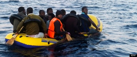 Would-be immigrants row in an inflatable boat off the Spanish coast, six miles (9.65 kilometers) from Tarifa, on November 13, 2012. Spanish emergency services and the Red Cross intercepted the boat carrying 10 sub-Saharan would-be immigrants off the Spanish coast, near Tarifa (southern Spain), as the country faces several weeks to an influx of illegal immigrants trying to cross the Strait of Gibraltar. AFP PHOTO / MARCOS MORENO